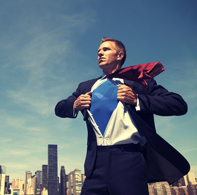 Superhero businessman standing outdoors changing saving the day above the city skyline